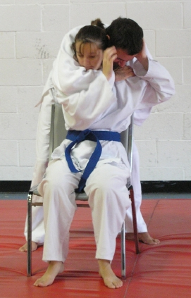 defending against an attack while seated